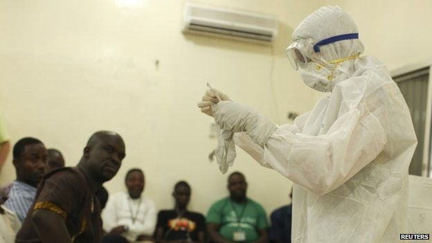A Samaritan's Purse medical worker demonstrates personal protective equipment to educate team members on the Ebola virus in Liberia (undated photo)