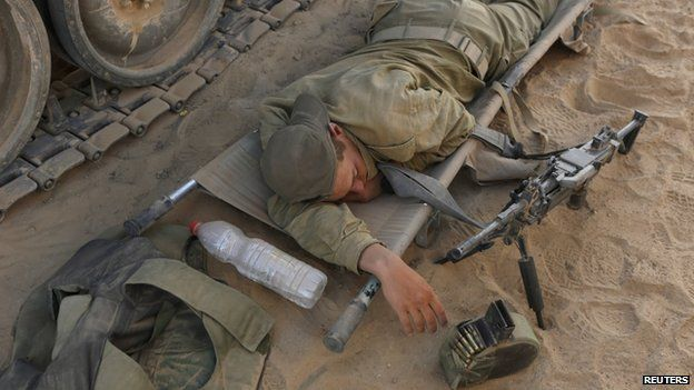 An Israeli soldier rests on a stretcher near the border with the Gaza Strip