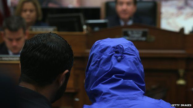 Caesar, hooded during the hearing