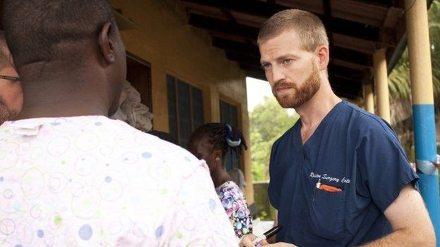 Dr. Kent Brantly (R) speaks with colleagues at the case management center on the campus of ELWA Hospital in Monrovia, Liberia