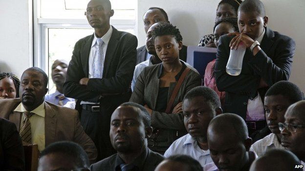 Ugandan human rights activists stand at the Constitutional Court in Kampala , Uganda - 30 July 2014