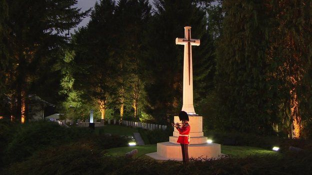 Last Post being played at St Symphorien Military Cemetery