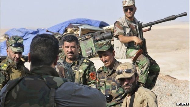 Peshmerga forces stand guard on the outskirts of Sinjar, west of Mosul on 5 August 2014.