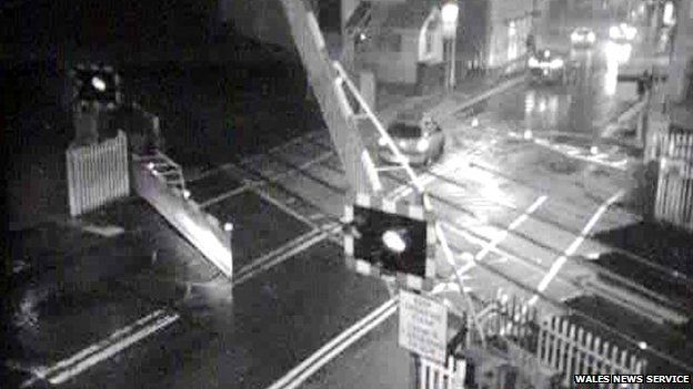 Sion Ramson drives over the level crossing