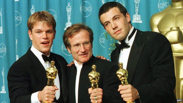 Williams with his Oscar, flanked by co-stars Matt Damon and Ben Affleck