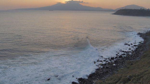 Volcano Mendeleyev is silhouetted against the sunset on Kunashir Island, one of the Kuril Islands,
