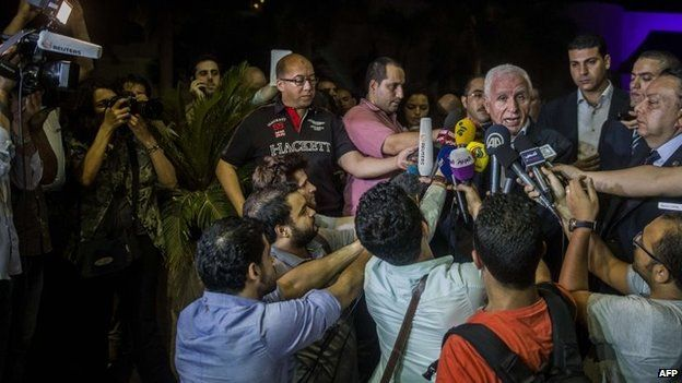 Head of the Palestinian delegation Azzam al-Ahmed gives a press conference at a hotel in Cairo, 13 August 2014
