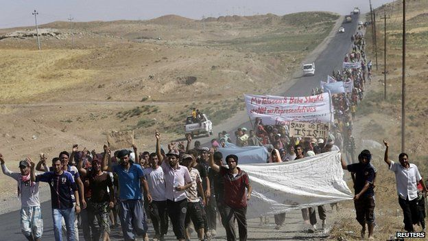 Displaced Iraqis from the Yazidi sect demonstrate at a border crossing with Syria in Dahuk province