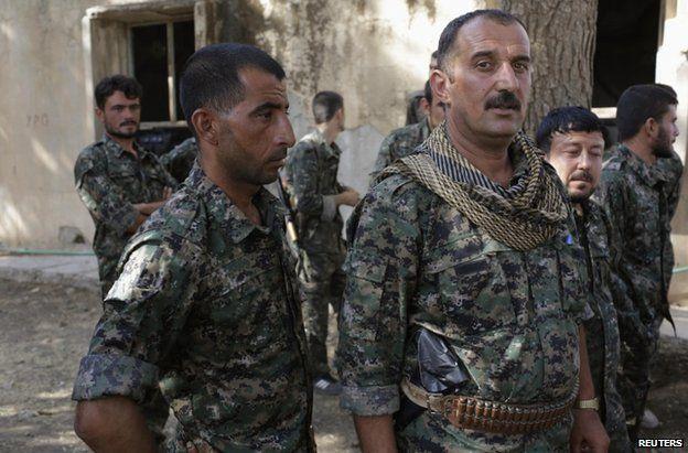 Iraqi Yazidi recruits under training with Kurdish forces in Qamishli, north-eastern Syria, 16 August