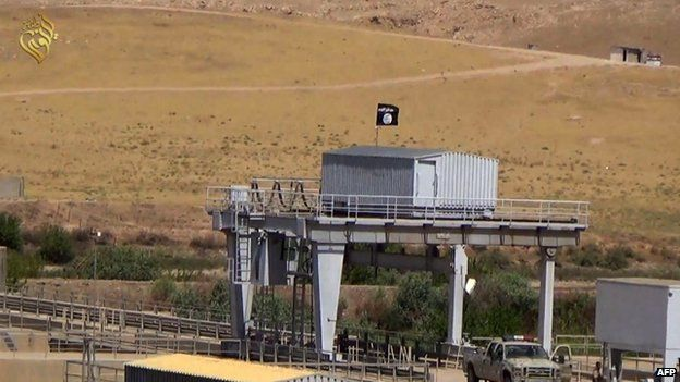Grab from video allegedly showing jihadi flag flying from building on Mosul dam - 9 August