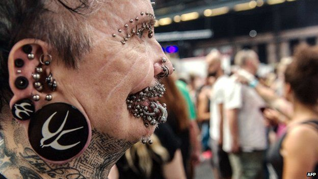 Rolf Buchholz, the worlds most pierced man, attends a tattoo convention in Berlin on 2 August 2014.