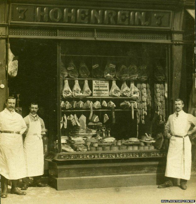 The Hohenrein bothers in front of their shop