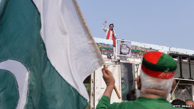 Imran Khan making a speech on top of his shipping container