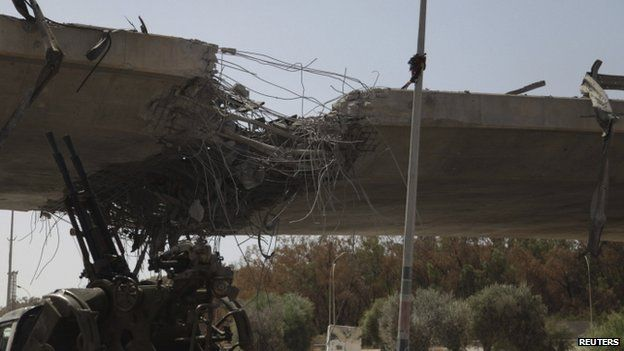 Damage to a bridge linking Tripoli and the western Libyan cities following clashes between rival militias west of Tripoli