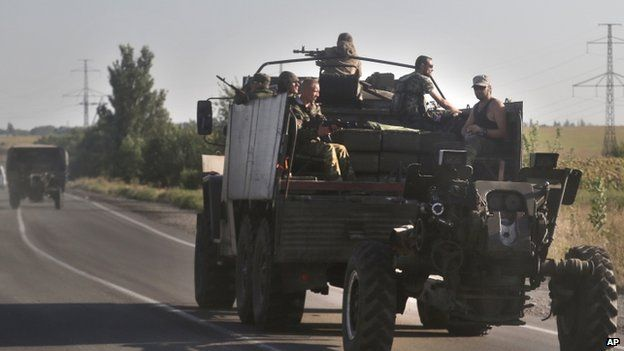 Pro-Russian rebels ride aboard a vehicle on a road near the town of Makeyevka, eastern Ukraine (23 August 2014)