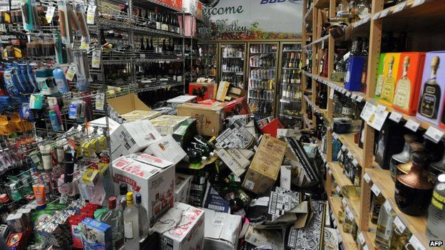 Bottles of liquor are strewn about inside Val's Liquor in downtown Napa (24 August 2014)