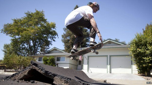 A skater took advantage of a buckled street after a 6.1 magnitude earthquake hit Napa (24 August 2014)