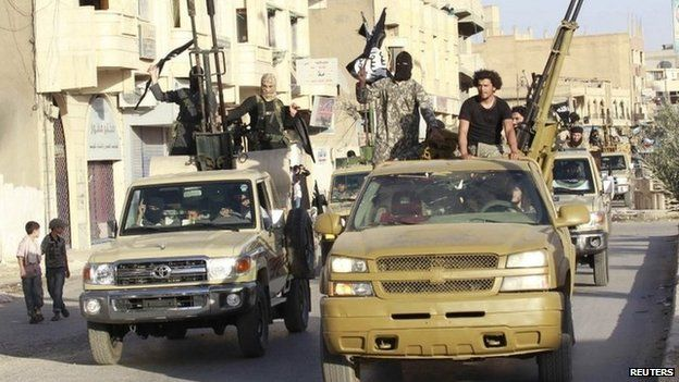 Islamic State fighters parade through the Syrian city of Raqqa (30 June 2014)