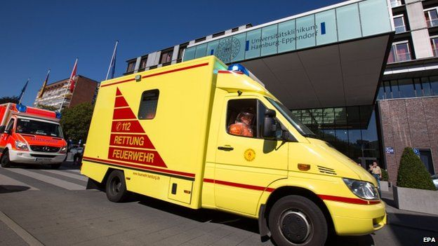 A convoy of rescue vehicles passes the main entrance of the University Hospital Hamburg-Eppendorf in Hamburg, Germany, 27 August 2014