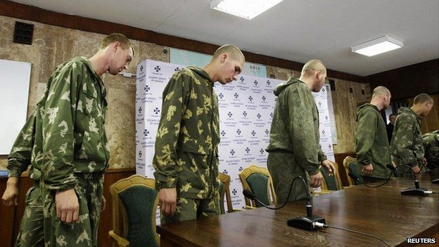 A group of Russian servicemen, who are detained by Ukrainian authorities, arrive at a news conference in Kiev - 27 August 2014
