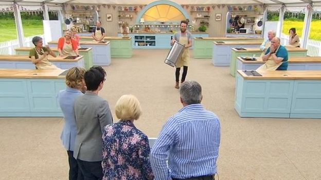 Iain bringing his bin up to the Bake Off judges