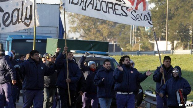 Strikers march in a second general strike in Argentina this year.