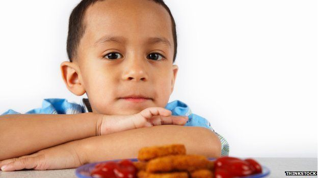Child with chicken nuggets