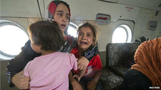 A woman and children in an Iraqi military helicopter evacuated from Amerli on August 29 2014