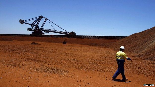A worker at the Fortescue loading dock located at Port Hedland in the Pilbara region of Western Australia in this 3 December 2013 file photo