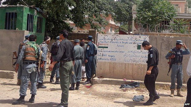 File photo: Afghan policemen stand at the site of a suicide bombing in front of the provincial council building in the city of Pul-e-Khumri, capital of northern Baghlan province, 20 May 2013