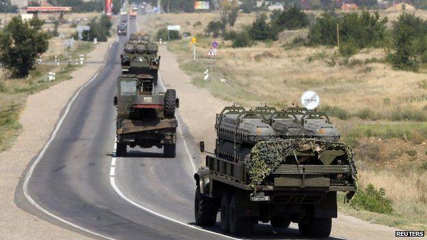 Russian military vehicles drive along the road outside Kamensk-Shakhtinsky, Rostov region, Russia, 16 August 2014