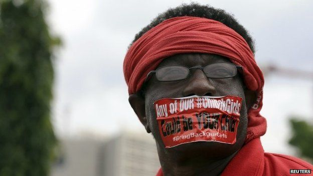 A demonstrator looks on during a rally that was held to mark the 120th day since the abduction of two hundred school girls by the Boko Haram, in Abuja (12 August 2014)