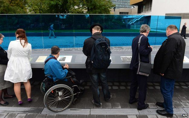 """Visitors at the memorial in Berlin to the 300,000 victims of the Nazi """"euthanasia"""" programme"""
