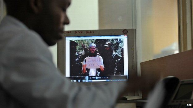 """An undated photo of Omar Hammami [C] aka """"the American"""" taken at an undisclosed location is seen on a computer screen in Nairobi, Kenya on 7 February 2013"""