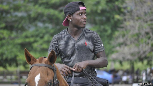Young trainer on a polo pony