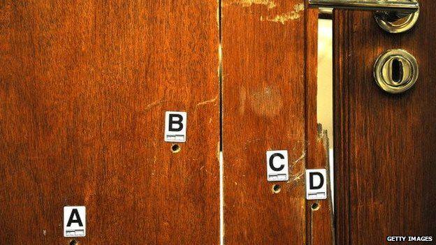 Bullet holes in Oscar Pistorius' toilet door