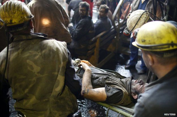 An injured miner is carried from the Raspotocje coal mine in Zenica, 5 September