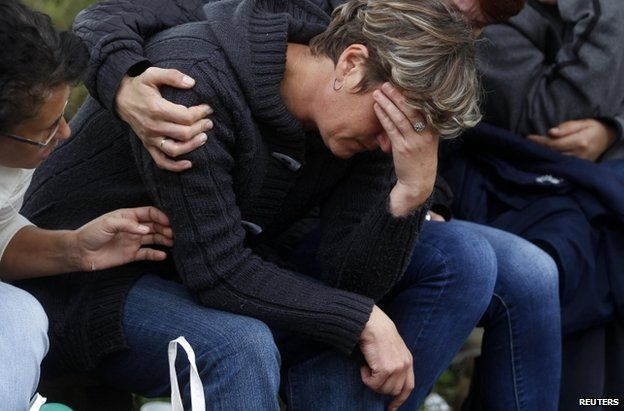 A woman is comforted outside the Raspotocje coal mine in Zenica, 5 September