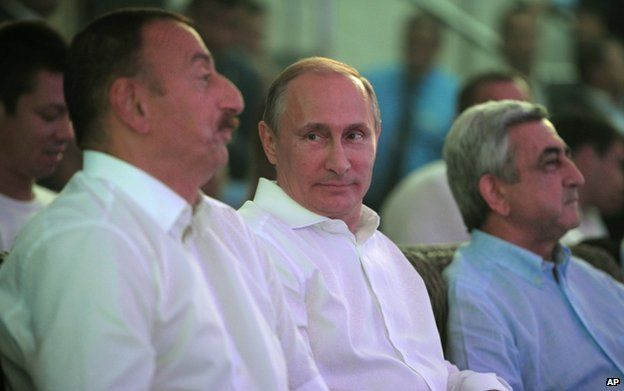 Russian President Vladimir Putin (centre) with Azerbaijani President Ilham Aliyev (left) and Armenian President Serge Sarkisian in Sochi, 9 August
