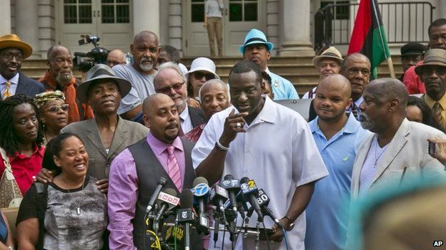 Three of five men exonerated in Central Park jogger rape case at news conference at City Hall, New York. 27 June 2014