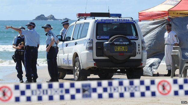 Members of the Australian Police inspect Clarkes Beach at Byron Bay in New South Wales, Australia on 9 September 2014
