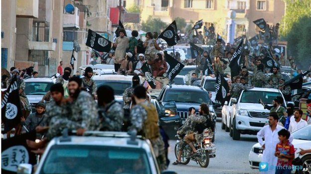 Islamic State fighters parade in Raqqa (June 2014)