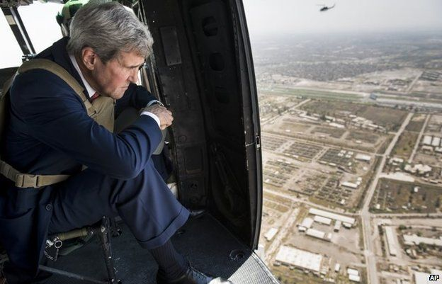 John Kerry looks out from a helicopter over Baghdad, September 10