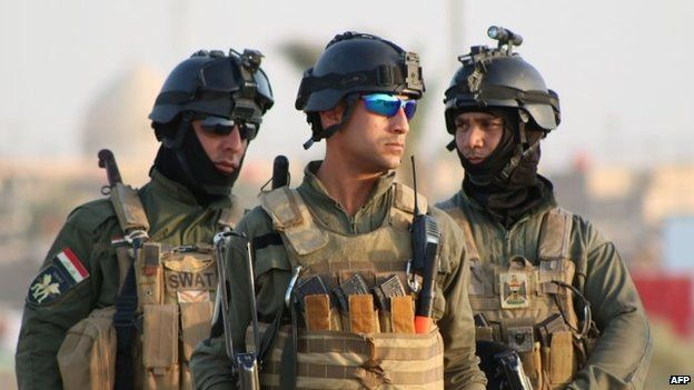 Iraqi special forces look on during a graduation ceremony for militiaman from the New Forces Regiment in the southern port city of Basra on September 9