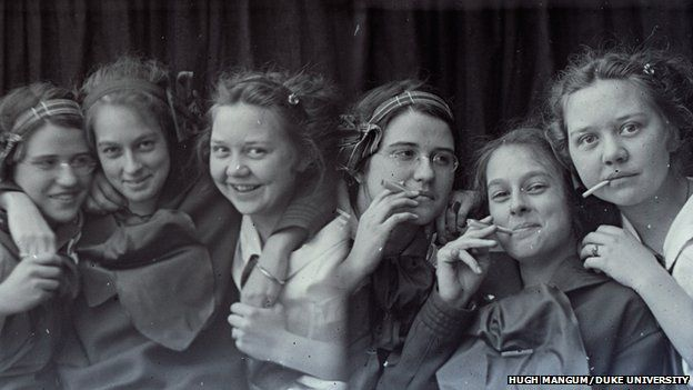 Two images of three girls smiling and pretending to smoke