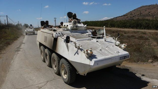 UN Disengagement Observer Forces (UNDOF) armoured vehicles at the Quneitra crossing in the Golan Heights (10 September 2014)