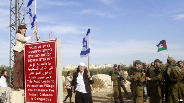 Israeli settlers, protected by soldiers, clash with Palestinians