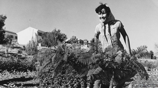 A woman works on a kibbutz in Israel in 1950