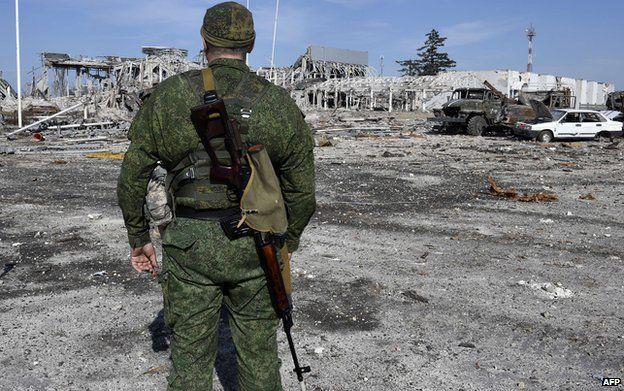 Rebel soldier and devastated Luhansk airport, 11 Sep 14