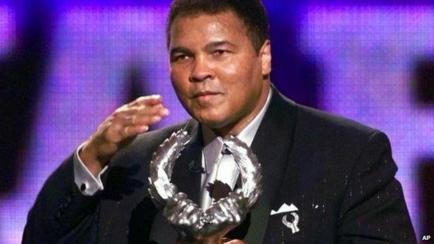 Boxing legend Muhammad Ali blows a kiss after receiving Sports Illustrateds 20th Century Sportsman of the Century Award in 1999